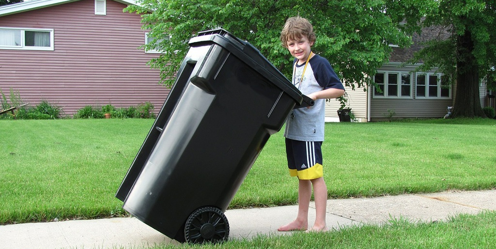 Boy with black bin