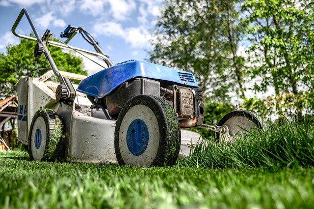 Blue lawn mower on grass